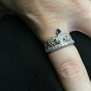 White and blue sapphire crown ring